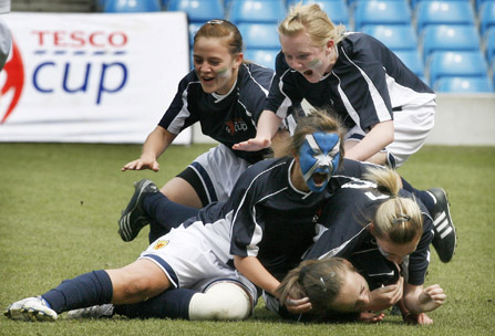 Scotlands U15 Girls team celebrate victory in their final of the Tesco Cup